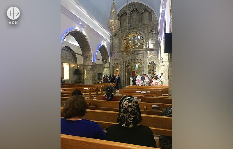 바르텔라로 돌아오는 그리스도인들 (출처=ACN 자료사진)