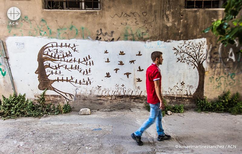 다른 나무로 안전하게 날아가는 새들이 그려진 그래피티 (출처=ACN자료사진)